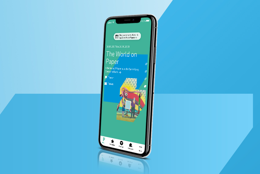 Smartphone with the PalaisPopulaire app on screen